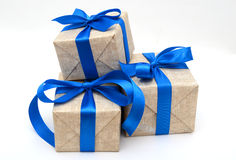 Gift wrapped blue ribbon. Isolated on white, Christmas and New Years box Royalty Free Stock Photography