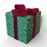 Gift wrapped box in green and silver with a red satin bow. A gift wrapped box for any occasion with embossed silver decoration on a green background. Suitable Stock Image