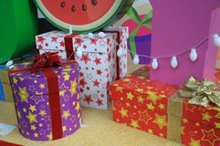 Gift wrapped boxes of different shapes. A photo taken on some gift wrapping boxes christmas presents with bows and ribbons. The boxes come in round, rectangle Stock Photo