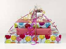 Gift Wrapped Boxes and Ribbons. Gift wrapped stacked presents and ribbons against a white background stock image