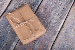 Gift Wrapped in Brown Paper Stock Photo