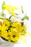 Gift wrapped flower arrangement. Bunch of freshly cut white carnation flowers, yellow liliums, lilly bulbs and yellow carnations arranged in a simple floral Stock Images