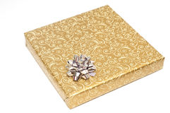 Gift wrapped in a golden paper Stock Photography