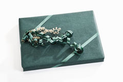 Gift wrapped with green wrapping paper Stock Photos