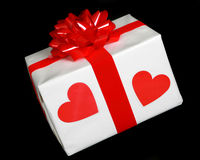 Gift wrapped present with two red hearts Stock Photography