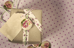 Gift wrapped in recyclable paper, ribbons, decorated with wooden Stock Images