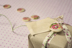 Gift wrapped in recyclable paper, ribbons, decorated with wooden Royalty Free Stock Photography