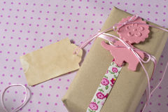 Gift wrapped in recyclable paper, ribbons and label flower Royalty Free Stock Image