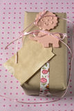 Gift wrapped in recyclable paper, ribbons and label flower Stock Images