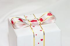 Gift wrapped with ribbon Stock Photos