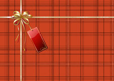 Gift wrapping. Vector illustration of Scottish plaid gift wrapping with golden ribbon, bow and red empty tag Royalty Free Stock Photo