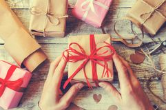 Gift wrapping for the beloved. royalty free stock photography