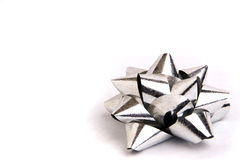 Gift Wrapping Bow. A single metallic silver gift wrapping bow royalty free stock image