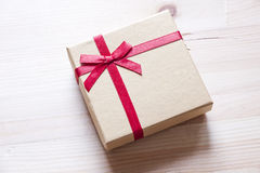 Gift wrapping. Gift box on light background Stock Images