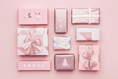 Gift wrapping composition. Beautiful nordic christmas gifts isolated on pastel pink background. Pink colored wrapped gift boxes. royalty free stock images