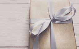 Gift wrapping. Modern holiday present in box Stock Images