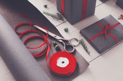 Gift wrapping. Packaging modern christmas present in boxes Royalty Free Stock Photography