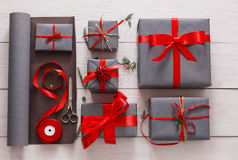 Gift wrapping. Packaging modern christmas present in boxes stock image