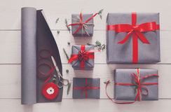 Gift wrapping. Packaging modern christmas present in boxes Royalty Free Stock Images