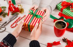 Gift wrapping. Packaging modern christmas present in boxes Stock Photography