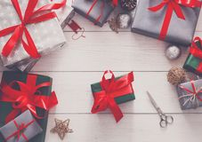 Gift wrapping. Packaging modern christmas present in boxes Stock Photos