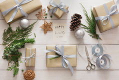 Gift wrapping. Packaging modern christmas present in boxes Royalty Free Stock Photos