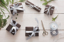 Gift wrapping. Packing modern christmas present in boxes Stock Photos