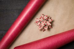Gift wrapping paper and bow on table - top view Christmas preper stock photo