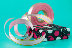 Gift Wrapping Party Time with  Ribbon Bows, Scissors and Tape on Royalty Free Stock Photography