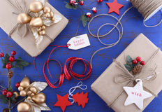 Gift wrapping presents on dark blue table. Stock Photos