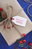 Gift wrapping presents on dark blue table. Royalty Free Stock Images