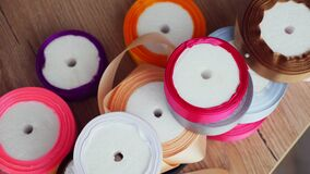 Gift wrapping ribbons. multicolored silk ribbons, ribbon reels for packaging, gift decoration. sewing accessories