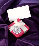 Gift wrapping and ring Stock Images