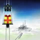 Gift wrapping in sky space elevator concept above city Stock Photo