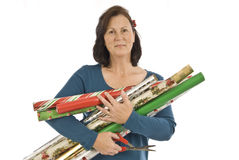 Gift Wrapping Time. Woman holding a lot of rolls of gift wrapping paper. On a white background stock photo