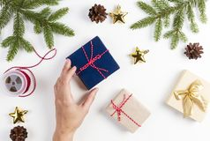 Gift wrapping. Woman packing gifts for Christmas Stock Photo