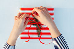Gift wrapping. Woman packs gifts, step by step Stock Photography