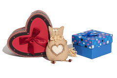 Gift wrappings. Red and blue gift boxes on a white background. Cat toy of handmade Royalty Free Stock Photography