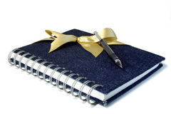 The gift writing complete set. Gift set including a notebook and the pen on a white background Royalty Free Stock Images