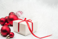 Gift and xmas balls Royalty Free Stock Photography