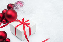 Gift and xmas balls Royalty Free Stock Photos