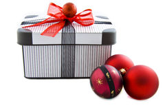 Gift xmas box. Striped gift box decorated with balls isolated over white Royalty Free Stock Images