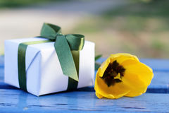 Gift with yellow flower Stock Photo