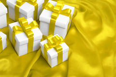 Gift on yellow satin background Royalty Free Stock Image