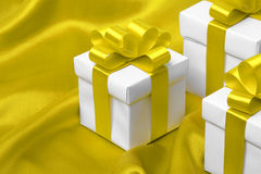 Gift on yellow satin background Stock Images