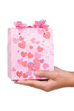 Gift for you. Hand holding a gift, shot vertical Royalty Free Stock Image