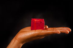 A gift for you. African American woman with a red gift box for you royalty free stock photos