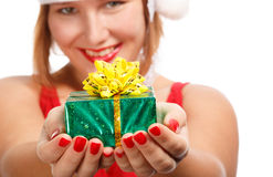 Gift for you. Beautiful young woman in santa claus suit holding green gift box isolated on white background Royalty Free Stock Photos