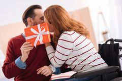 Handicapped woman kissing her man Stock Images