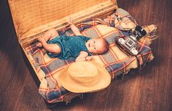 Gift for you. Family. Child care. Small girl in suitcase. Traveling and adventure. Sweet little baby. New life and birth. Portrait of happy little child royalty free stock photography